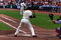 Marco Scutaro taking a high pitch from Adam Wainwright